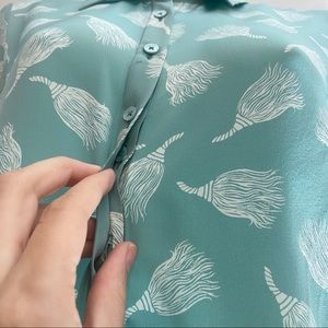 The Shirt by Rochelle Behrens Tops - Teal Halloween Broom Button Front Silk top